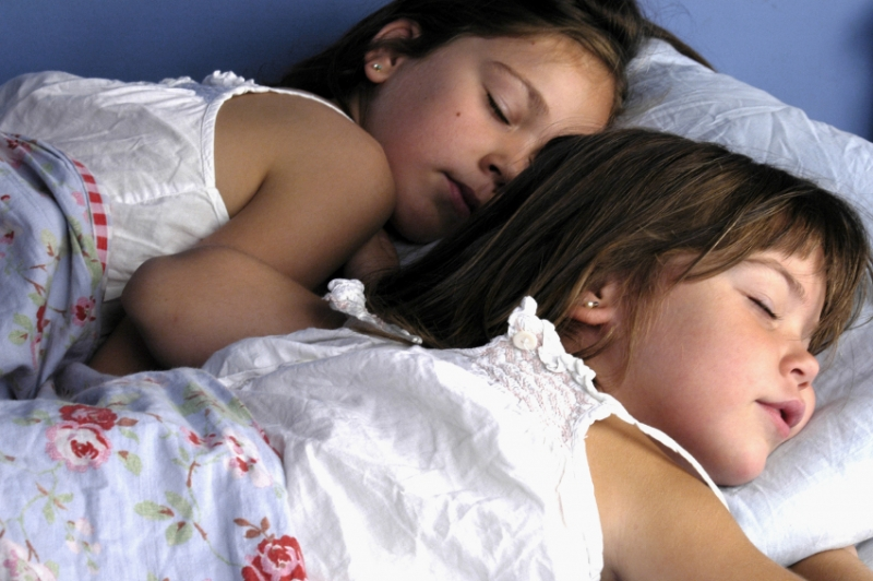 children sleeping indoors